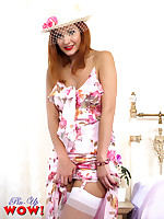 A sexy striptease by a cute blonde in a pretty summer dress, lingerie, stockings and suspenders