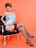 Gorgeous Elle Richie delivers a perfect striptease from sexy satin corset and black stockings