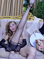 Gorgeous babe tries on retro style gloves with classy nylons and suspenders