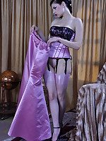 Glamour babe strips her long evening gown revealing pink satin top nylons