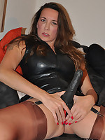 Jane is hiding a big sex toy between her nylon covered legs and it looks fucking good