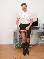 Secretary in boots changing her stockings in the office