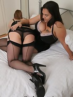 two girls in stockings and a corset spanking each others bums