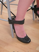 Stockings slave tied to a chair