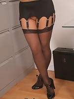 Secretary in pantyhose and stockings stripping in the office